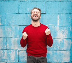 Man smiling and happy about making money online with Inspire Designz