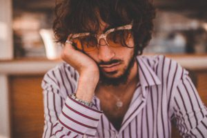 Inspire designz: Photo of man frustrated sitting at table