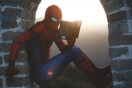 What Is Seo Keyword Research: Photo of spider man reading on a building top