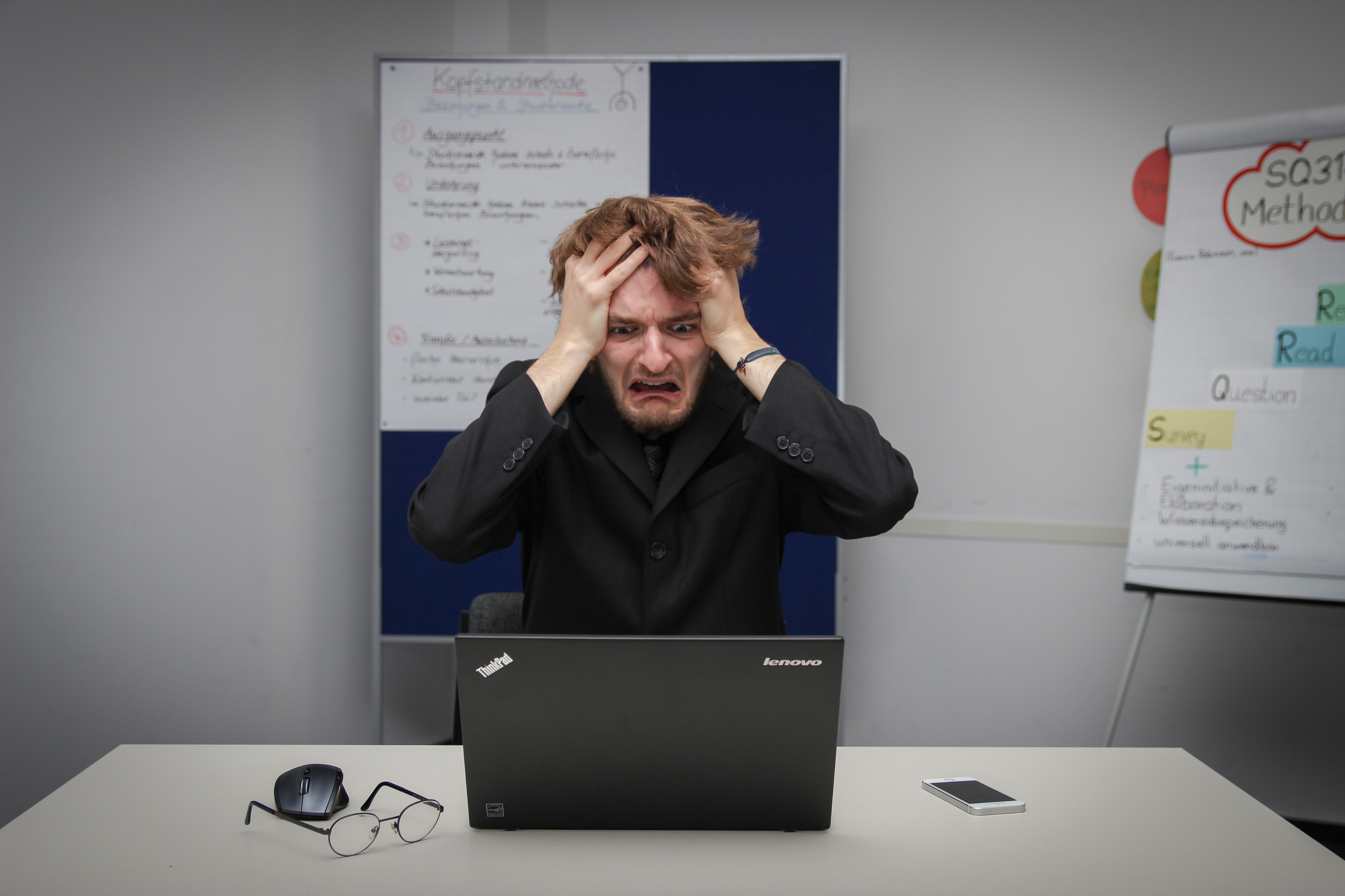 Free funnel builder software: Photo of man being frustrated at computer