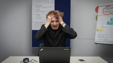 affiliate marketing and facebook ads: photo of man frustrated at the computer